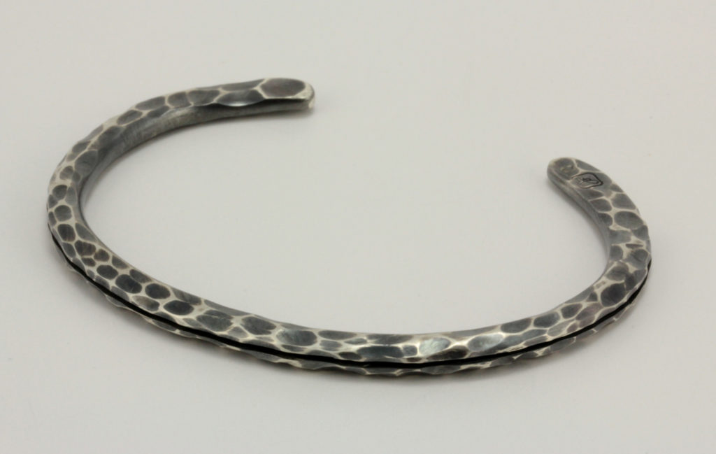 "Oxidized sterling silver ""joe,"" bracelet with a highlighted hammered finish."