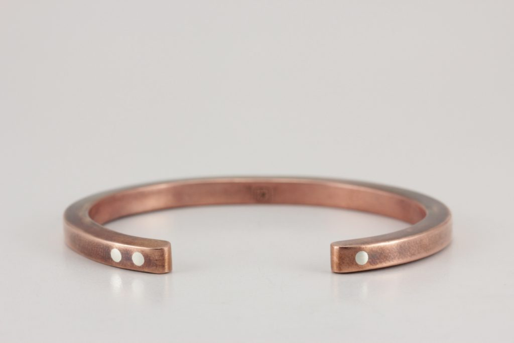 worn copper antithesis bracelet